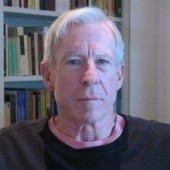 a headshot-style picture of Steve Crowell, with a bookshelf in the background